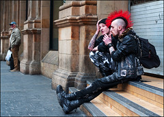 Flaming mohican (Charles Hamilton Photography) Tags: red people punk glasgow candid streetphotography smoking flame centralstation mohican nikond90 glasgowstreetphotography