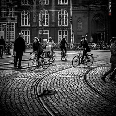 Curves, circles and parallelograms (Jeff Krol) Tags: street blackandwhite bw netherlands monochrome lines amsterdam bike canon square eos cycling women track noir circles pigeon curves wheels flight streetphotography tram bicycles explore traintrack rectangle f28 2012 70200mm parallelogram 70200l explored ef70200mmf28lusm 60d img7413 canon60d jeffkrol