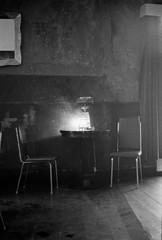 Canon AV1 + Ilford FP5 Plus (Giu Behringer) Tags: old blackandwhite bw lamp fog analog canon table photography photo cafe moody belgium chairs room antwerp ilford av1 korsakov fp5plus