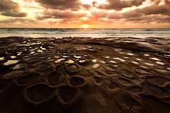 La Jolla Sunset (boingyman.) Tags: sunset seascape reflection clouds canon landscape sandiego lajolla scape 1022 potholes foreground waterscape hospitals uwa t2i boingyman