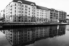 Channel Reflection (Rutger Blom) Tags: houses blackandwhite bw reflection building water architecture mirror skåne facades malmö reflexion vatten channel malmo scania 52mm reflectie spegelbild canonpowershots100 5226mm