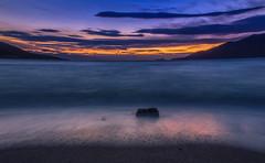 Solitude... (Vagelis Pikoulas) Tags: sunset sea sky cloud sun rock clouds spring waves wave greece porto germeno