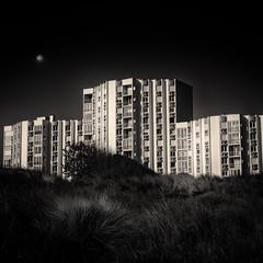 Invasion of the dunes, Leffrinckoucke, France, 2014 (janbeernaert) Tags: urban blackandwhite bw moon france building zwartwit dunes duinen urbanscape urbanlandscape maan blackandwhitefineartphotography olympusomdem5 janbeernaert