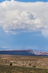 Ominous Above the Rocks (waterrocksnow) Tags: light cloud storm contrast sandstone desert sage redrocks moab archesnationalpark juniper thunderhead