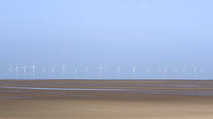 Floating Turbines (JodBart) Tags: beach water still reflections horizon crosby blue sand orange turbines