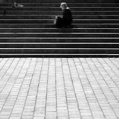Watching the birds (Andrew Malbon) Tags: street bw woman bird lady square reading flying blackwhite waiting alone pigeon watching steps streetphotography sigma lunchtime landing paving fixed southsea merrill guildhall foveon apprehensive fixedlens dp3 strongisland portsmouthguildhall fixedfocallength dp3m sigmadp3