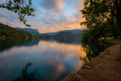 Lake Bled (billydorichards) Tags: shoreline landscape sunset alpine nature water mountains outdoors vacation canon6d summerholiday lakebled wideangle longexposure blue adventure orange outside travel reflections scenic clouds sky slovenia wild canon1635mmf4l waterblur alps