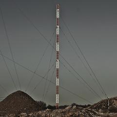 billwerder moorfleet IX [andre gansebohm] (Andre Gansebohm) Tags: germany dark square grit hamburg calm pole wires gravel muted billwerder moorfleet