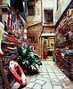 [A bookshop in Venice] (uηderaglassbell) Tags: street longexposure venice italy fuji books slidefilm velvia 55mm 6x7 expired bookshop venezia e6 100f pentax67ii underaglassbell smcpentax6755mmf4