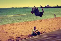 Day 105 - Jump Up & Get Down (vorka70) Tags: boy summer motion beach water st youth fun bay jump jumping sand action path spin australia melbourne flip acrobatics teenager boardwalk nikkor stkilda kilda portphillipbay stkildapier nikond90 peopleandpaths vorka70