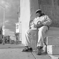 (patrickjoust) Tags: street portrait people urban bw usa white man black 120 6x6 tlr blancoynegro film home analog america square lens person us reflex md focus sitting fuji mechanical united north steps patrick twin maryland 11 baltimore east fujifilm medium format neopan 100 states manual nikkor 80 joust develop acros estados xtol 80mm f35 greenmount blancetnoir unidos airesflex schwarzundweiss autaut patrickjoust deveoped