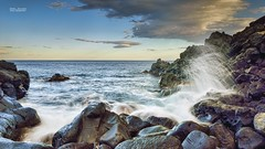 Waves on the rocks (Andrea Rapisarda) Tags: longexposure sky italy seascape clouds nikon rocks italia nuvole mare cielo sicily 169 catania sicilia onde d800 scogliera cannizzaro schizzi nohdr nikon2470mmf28