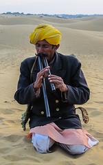 A man playing flute in Thar desert, Jaisalmer, Rajasthan, India (karanmitra) Tags: music man art canon dessert flute powershot getty jaisalmer rajasthan thardessert ixus95is canonixus95is sd1200 canonpowershotsd1200