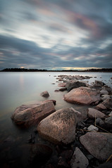 Nicely lined up II (- David Olsson -) Tags: longexposure sunset lake seascape motion reed nature water clouds landscape evening nikon rocks sundown cloudy sweden stones tripod sigma windy le april late 1020mm 1020 vänern 2012 dx hammarö värmland ndfilter lakescape smoothwater skoghall smoothsky d5000 mörudden davidolsson nd500 lightcraftworkshop 2exposuremanualblend