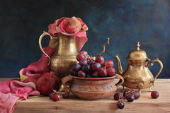 Eastern Song (panga_ua) Tags: light stilllife color art fruit composition scarf canon reflections spectacular artwork colorful ceramics shine artistic availablelight shapes pomegranate naturallight bowl ukraine poetic explore desire creation grapes imagination natalie oakwood sheen arrangement pleasure tabletop gettyimages bodegon naturemorte panga artisticphotography rivne naturamorta artphotography sharpfocus gauzy explored woodentabletop brassteapot brasspitcher  nataliepanga grapeberries pastelsbackground easternsong