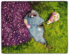 Flo Blows a Bubble (Do the Twist!) Tags: pink woman green art stone moss purple character afro humor bubble paving assembled assemblageart alienskinsoftware
