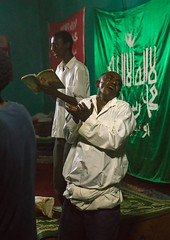Sufi people go into a trance during a ceremony, Harari region, Harar, Ethiopia (Eric Lafforgue) Tags: world africa travel people color men green vertical night religious outdoors togetherness dance clothing women worship singing dancing african flag muslim islam religion praying group performance performing ceremony dancer unescoworldheritagesite celebration indoors event spirituality ethiopia sufi sufism adultsonly trance hornofafrica chanting eastafrica harar abyssinia harari harariregion ethio163052