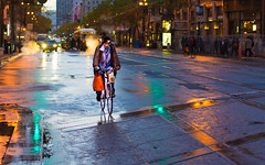 Lone Ranger (DobingDesign) Tags: sanfrancisco california road street travel light travelling wet bike bicycle lights cycling us twilight colours cyclist unitedstates outdoor dusk citylife streetphotography steam depthoffield sidewalk rainy biking bluehour puddles moist carheadlights nightcolours