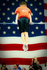 High Bar (Gold Element Photography) Tags: old boy portrait sports youth child action glory flag indoor gymnastics american gymanst