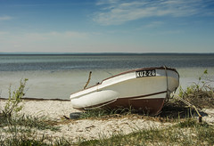 Boat at the seaside (Maciej Wojciechowski) Tags: blue sea vacation sky sunlight beach nature water landscape bay daylight boat seaside spring sand wasser outdoor bluesky baltic shore serene