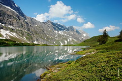 Trbsee (welenna) Tags: alpen alps switzerland summer snow schnee see schwitzerland sky swiss stone steine berge blue blumen natur natural mountains mountain morgen morning view landscape lake light wasserspiegel water wasser wolken clouds cloud serene trbsee green tree