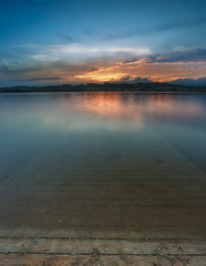 Dreamy (Alfredo.Ruiz) Tags: sunset lake nature clouds landscape spain ray footbridge