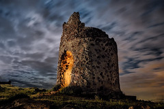The helmet (Luis Javier de la Fuente) Tags: old longexposure nightphotography blue light sky espaa lightpainting tower abandoned windmill yellow bulb night rural stars noche amazing nikon ruins torre nightscape shot nightshot wind ruin ruina molino ruinas cielo nubes estrellas nocturna nightlife nikkor nube watchtower nightscapes abandono lanter abandonado largaexposicion longexpo abanoned tomssnchez luisdelafuente nightpfotography lucesdelpasado