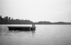 Lonely Raft (yesimahuman) Tags: vacation lake film wisconsin 35mm cabin minolta kodak trix 400 filmphotography srt100 cabinporn