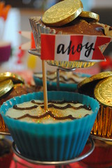 89/366 (fiona loves photos) Tags: party cupcakes waves flags homemade pirate icing ahoy pirateparty goldcoins doubloons