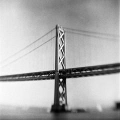 Bay Bridge (robert schneider (rolopix)) Tags: sanfrancisco california ca old blackandwhite bw blur 6x6 film monochrome mediumformat square blurry kodak funky calif baybridge brownie hawkeye damaged expired outdated 620 bhf browniehawkeyeflash flippedlens outofdate verichromepan 120620 robertschneider autaut believeinfilm simplebutkindacool rolopix
