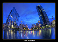 La Dfense by night (Jerem photographie) Tags: sky paris france tower colors night clouds photoshop buildings reflections french lights office nikon eau shoot cloudy lumire towers fisheye ciel bluehour nikkor nuages tours 8mm nuit reflets franais hdr parisian lumires ladfense reflects dfense fishy bureaux parisien nuageux d90 jerem photomatix nikor paname rgionparisienne heurebleue samyang nikonist flickraward francilien francilienne 5raw hdraward jazzbri jeremphotographie jrmiemaurin parisiansuburbs bleuehour