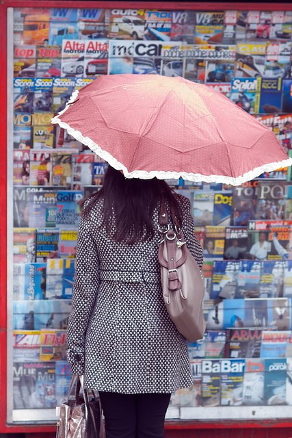 Woman with the pink umbrella.