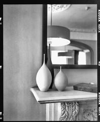 Mantle Vases (Tony_Roman_Photography) Tags: uk bw film kodak medium format 6x7 copyrighted trix400 mamiya7 bytony tonyroman tonyromanphotography tonyromanphoto imagebytonyromancopyrighted copyrightedbyanthonyproman
