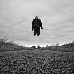 Ruthless Gravity (martinfowlie) Tags: road sky blackandwhite man grass tarmac clouds canon evening jump again jacket 7d lone remote 1020mm cambridgeshire messingabout craigarmstrong notbadforanoldman gotsomeair ruthlessgravity iusethisroadquitealot itisquietthough