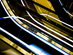 reflected neon light (JayPiDee) Tags: urban abstract reflection lines mall nikon curves escalator shoppingcentre coolpix shoppingcenter spiegelung abstrakt neonlight rolltreppe linien kurven neonlicht einkaufszentrum städtisch movingstairway friendlychallenges p7800 nikoncoolpixp7800