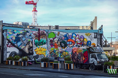 Colourful Christchurch (Steve Taylor (Photography)) Tags: city newzealand christchurch sky food streetart man art smile smiling wall truck bench fun skull graffiti mural sheep crane seat vivid canterbury busstop freak nz wilson southisland cbd colourful van tilt texmex locos wongi ketchbook deow