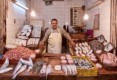Fes fishmonger (D A Scott) Tags: africa portrait fish shop canon morocco souk medina fishmonger fes shopkeeper