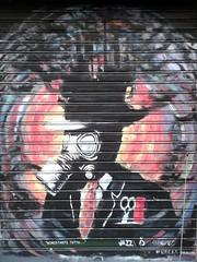 Atomic World (theuncle12) Tags: world street urban streetart black milan art graffiti mask milano explosion tie spray scissors graffito atomic murales nero comb mondo sprayart atomico forbici esplosione cravatta allchrome pettine