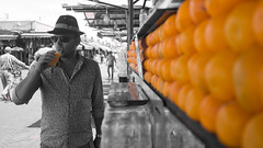Marrakech - Place Jamma El Fna - Orange Juice (aminefassi) Tags: voyage africa trip travel summer portrait people bw copyright food orange white color colour men blanco fashion lumix spring noir colours dof drink bokeh laranja panasonic morocco maroc chapeau marrakech marrakesh schwartz mode naranja blanc 2012 selective  depht login  fooding borsalino m43   fashionportrait frut   marueccos  microfourthirds  dmcgf3 aminefassi marrakechplacejammaelfnaorangejuice