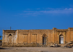 Old Italian Colonial Building, Ptolemais, Libya (Eric Lafforgue) Tags: africa color building horizontal architecture outdoors italia northafrica colonial bluesky nobody nopeople libya libia libye libyen colorpicture lbia ptolemais ptolemaida italiancolony cyrenaica libi libiya  ribia liviya libija colourpicture       lbija  lby  libja lbya liiba livi  a0014594