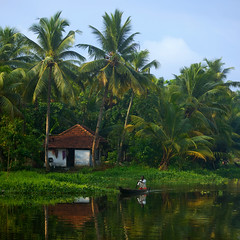 God's Own Country - Kerala (VinothChandar) Tags: india house color colour reflection green nature water colors beauty canon landscape photography boat photo fishing colorful photos pics vibrant picture houseboat pic kerala lush
