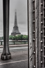 Lady in gray (Michel Couprie) Tags: bridge paris france metal seine clouds river tour metallic gray eiffeltower eiffel hdr birhakeim 100commentgroup