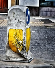 A tough job... (Toby King) Tags: road england traffic marker arrow kerb beacon scraped bashed bumped
