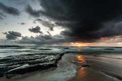 A glint in the eye of the storm (images through a lens) Tags: cloud sunrise dawn rocks stormy northumberland northsea northeast bamburgh