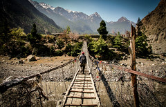 Just south of Marpha lies the Tibetan Settlement of Tserok. which is only reached by this suspension bridge. Mustang, Nepal. (eriktorner) Tags: nepal camp im refugee refugees tibetan mustang soir settlement marpha tibetansk flyktingar bosttning tserok