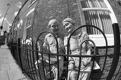 Couple(mono) (Peter Rea 13) Tags: street houses red blackandwhite brick manchester fisheye anita terraced