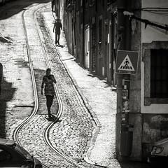 Lisbon: Pedestrians (PetterPhoto) Tags: street old blackandwhite bw portugal lady contrast vintage nikon noiretblanc lisboa lisbon candid streetphotography tram pedestrians nikkor tramlines oldlisbon petterphoto