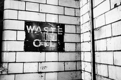 sign of the times (I AM JAMIE KING) Tags: brick texture sign wall architecture manchester fire rusty litter explore tiles oil waste firestation derelict flaky crusty patina develop redevelop londonroadfirestation