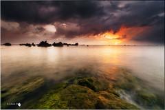 Luchando con las nubes (Caramad) Tags: longexposure sea seascape marina sunrise landscape mar agua rocks playa amanecer olas rocas cantabria marcantbrico playatrengandin
