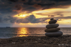 Zen (Mimadeo) Tags: sunset sea summer tower beach nature water rock stone relax outdoors sand peace pyramid symbol stones buddhism nobody stack pebble health pile zen harmony balance meditation concept relaxation spa heap tranquil stability